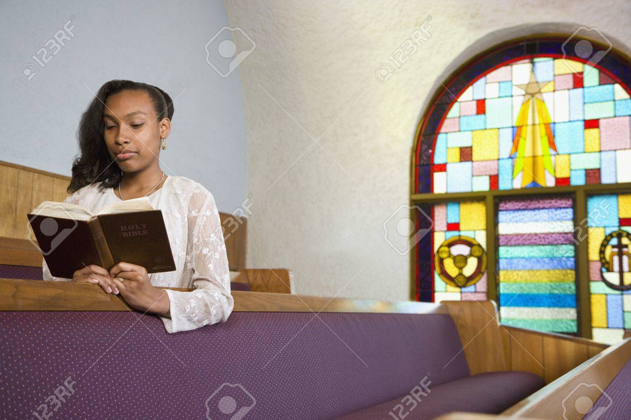 African American woman reading Bible in church Stock Photo - 16095121