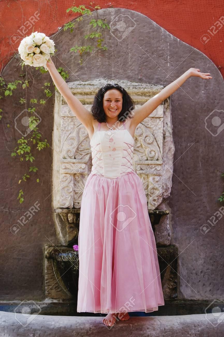 Hispanic girl wearing Quinceanera dress Stock Photo - 16095354