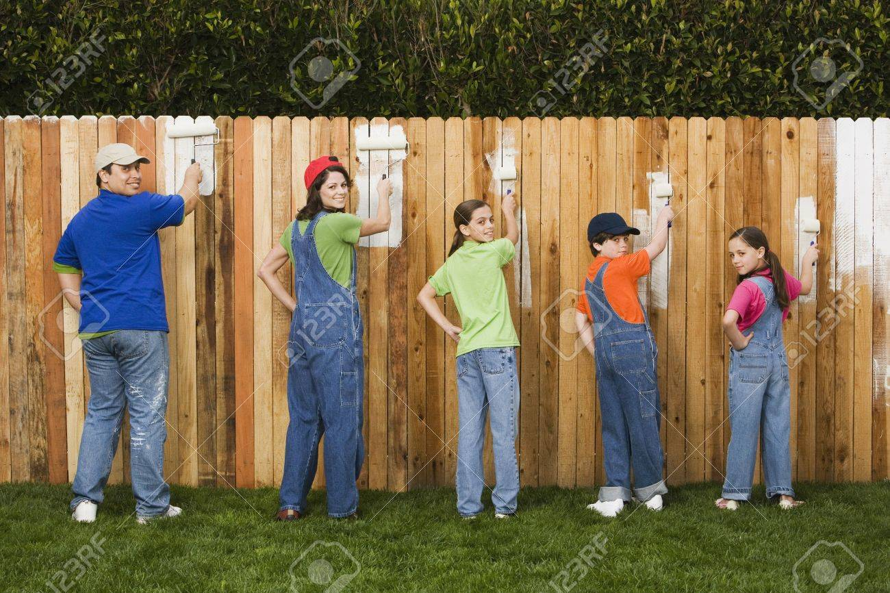 Mixed Race family painting fence Stock Photo - 16095498