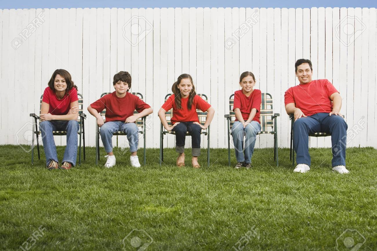 Mixed Race family sitting in lawn chairs Stock Photo - 16095507