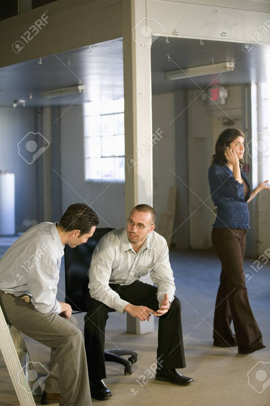 Young businesspeople in new office Stock Photo - 16095695