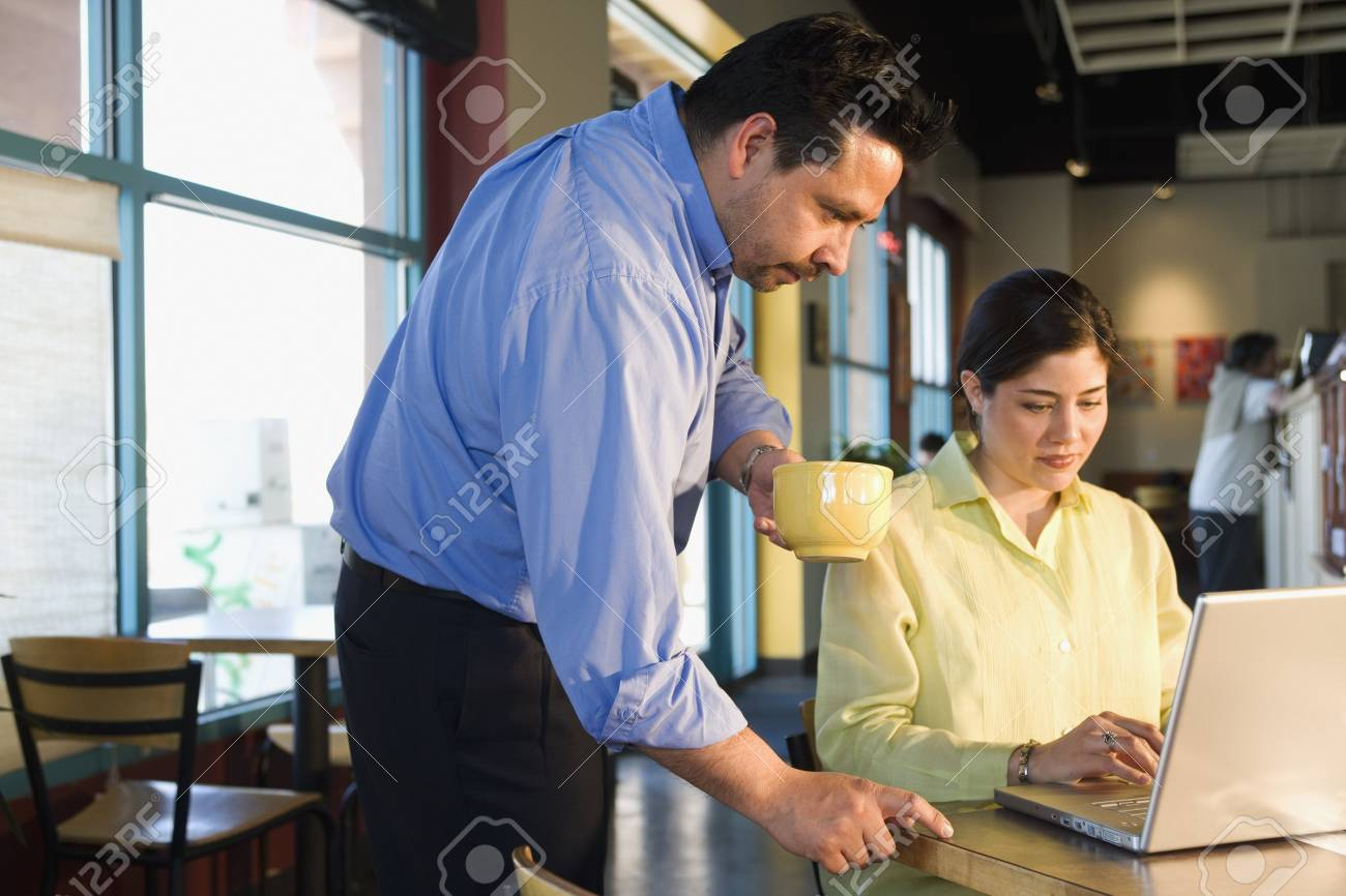 Multi-ethnic businesspeople working at cafe Stock Photo - 16095697