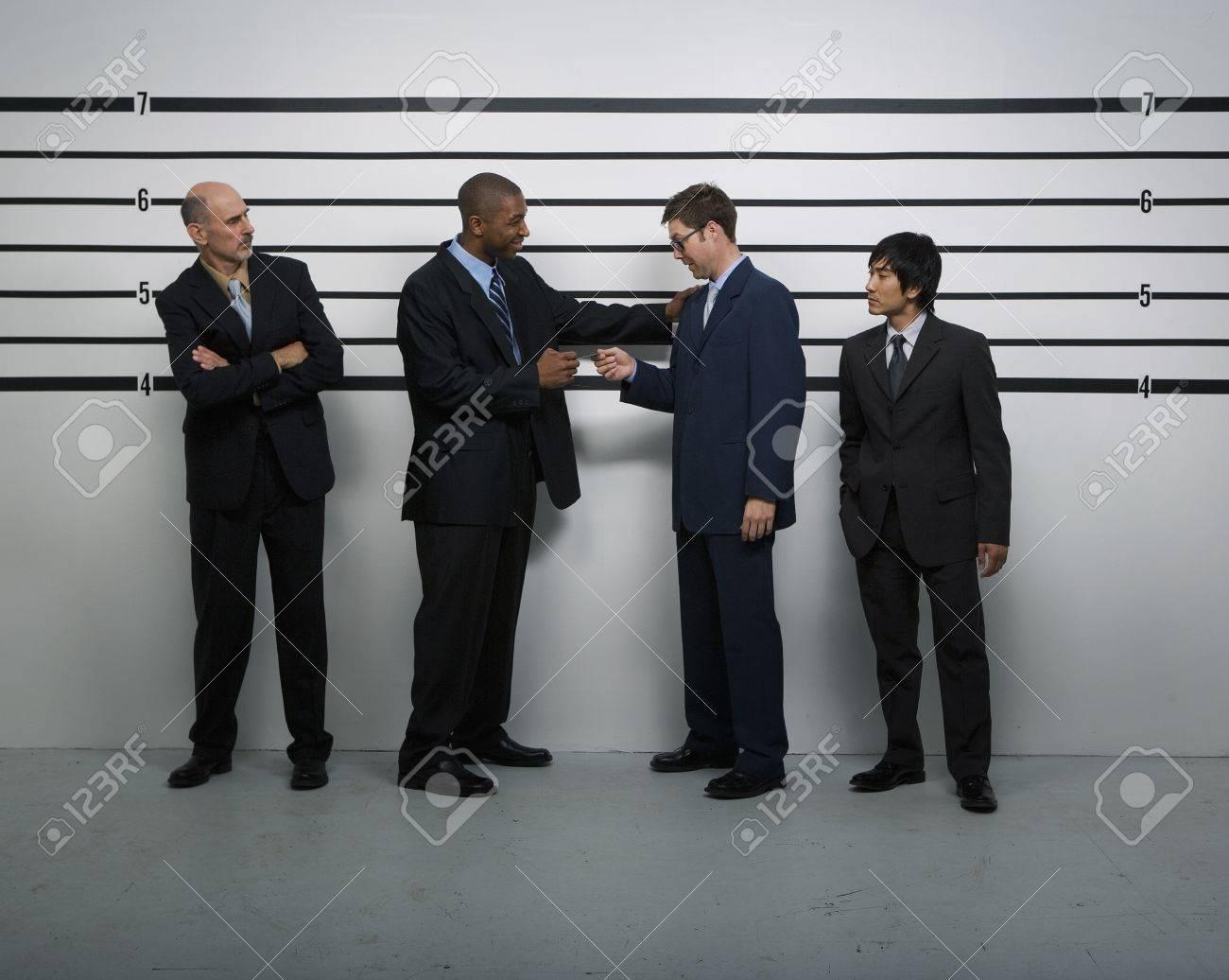 Multi-ethnic businessmen in police line up Stock Photo - 16095698