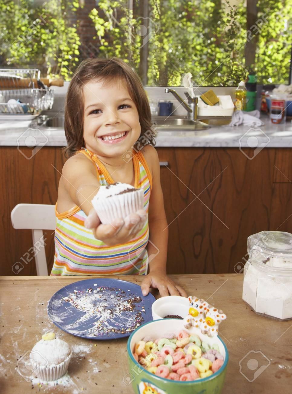 Hispanic girl holding homemade cupcake Stock Photo - 16095759