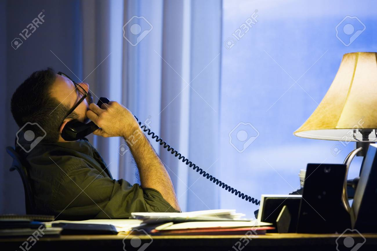 Hispanic businessman talking on telephone Stock Photo - 16095985