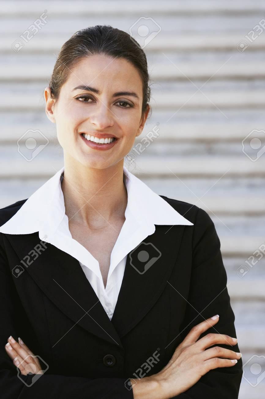 Hispanic businesswoman with arms crossed Stock Photo - 16096045