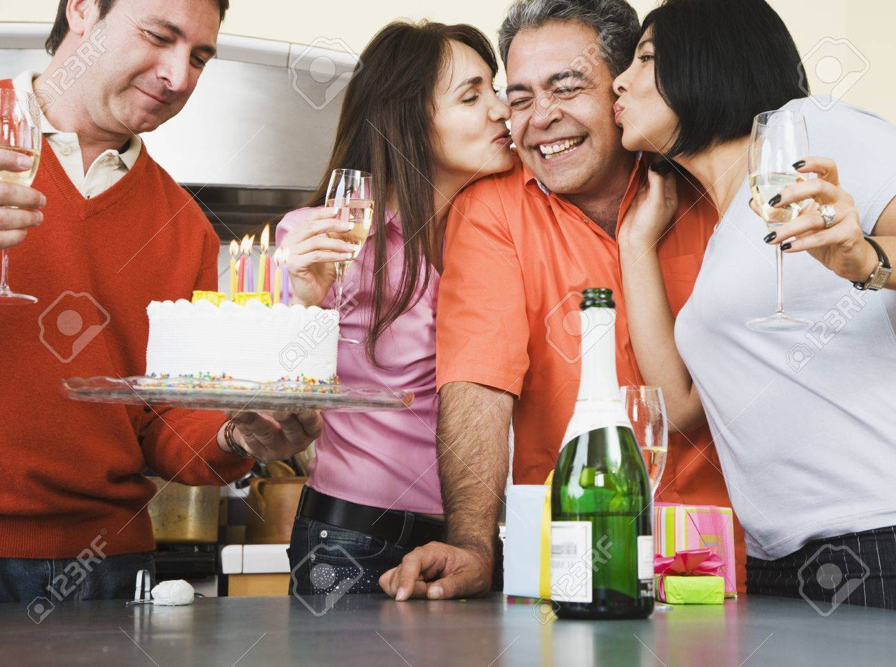 Middle-aged friends at birthday party Stock Photo - 16096076
