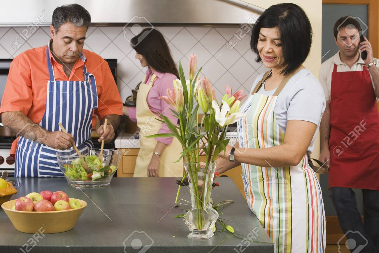 Two middle-aged couples in kitchen Stock Photo - 16096094