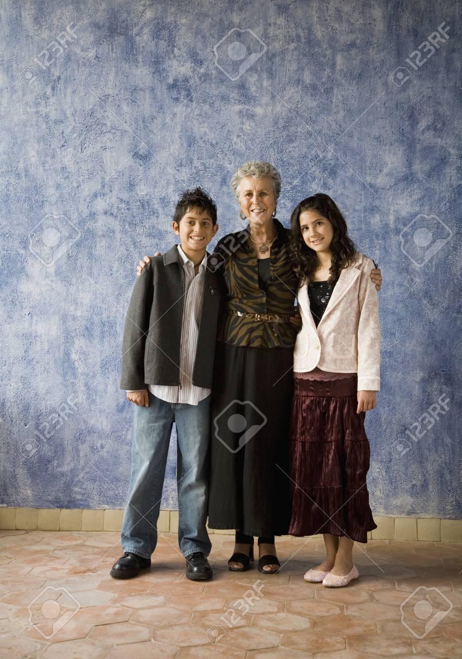 Multi-ethnic grandmother and grandchildren hugging Stock Photo - 16096173