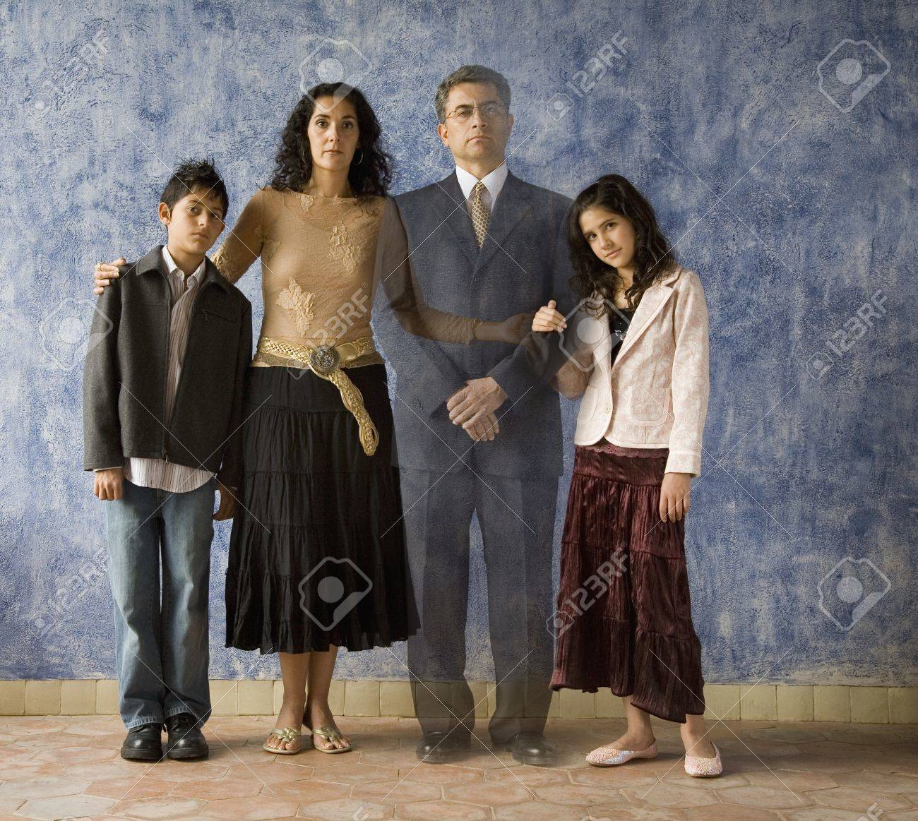 Portrait of Hispanic family with ghosted image of father Stock Photo - 16096184