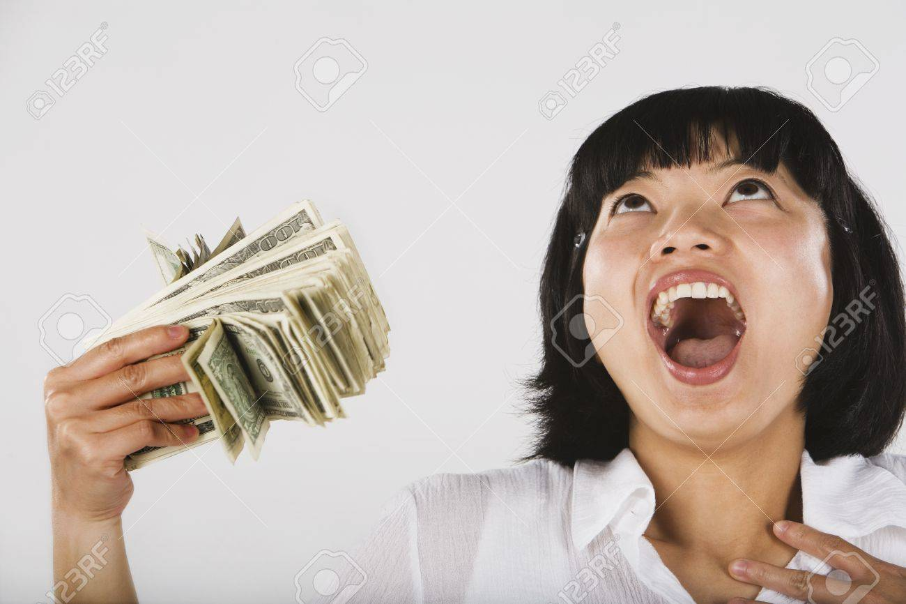http://previews.123rf.com/images/bst2012/bst20121412/bst2012141208992/35678676-Asian-woman-fanning-self-with-money-Stock-Photo.jpg