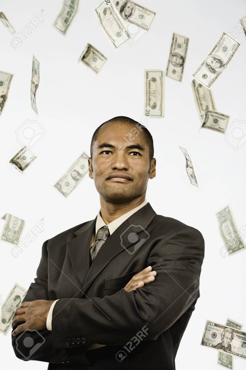 Money Raining Down On Asian Businessman Stock Photo Picture And