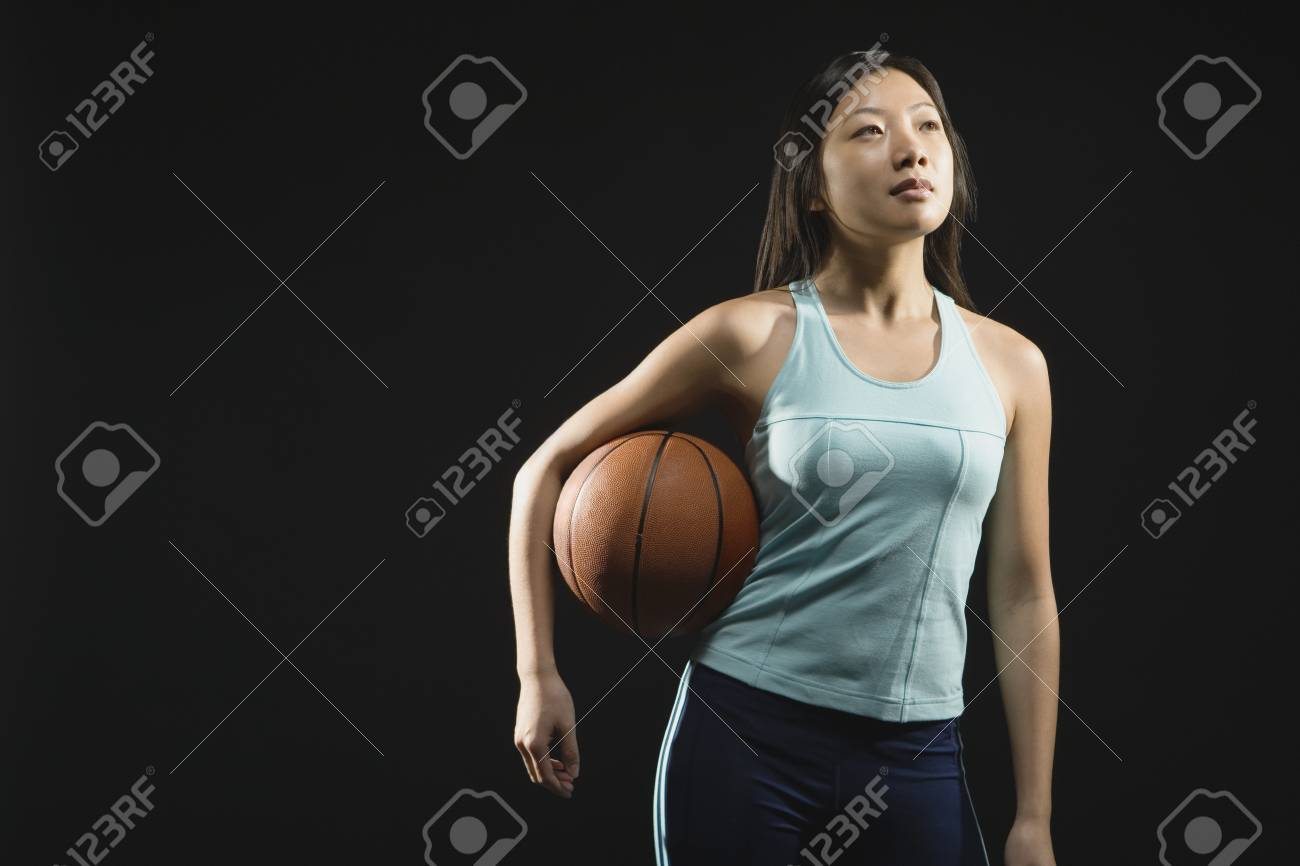 asian woman holding basketball stock photo picture and royalty free