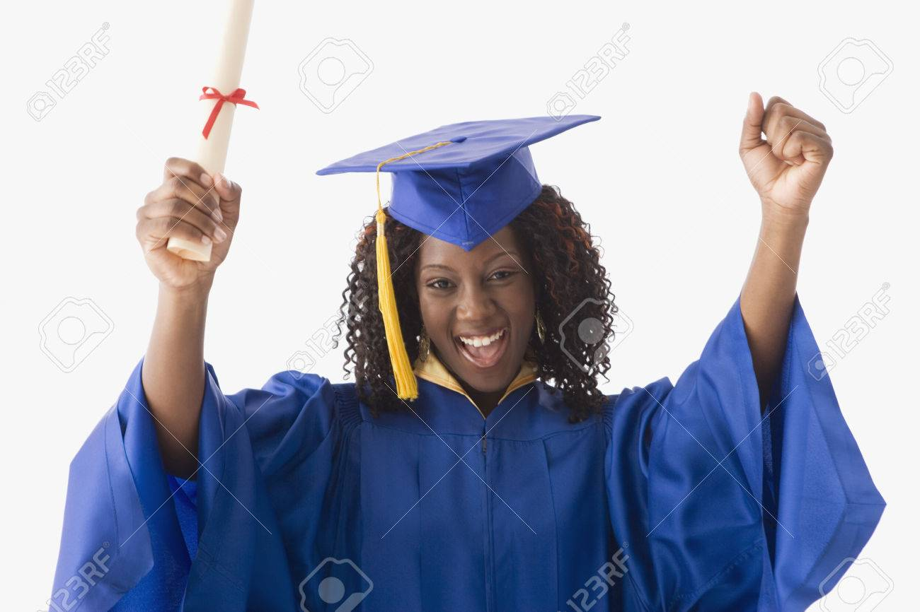 African American Woman Wearing Graduation Cap And Gown Stock Photo ...