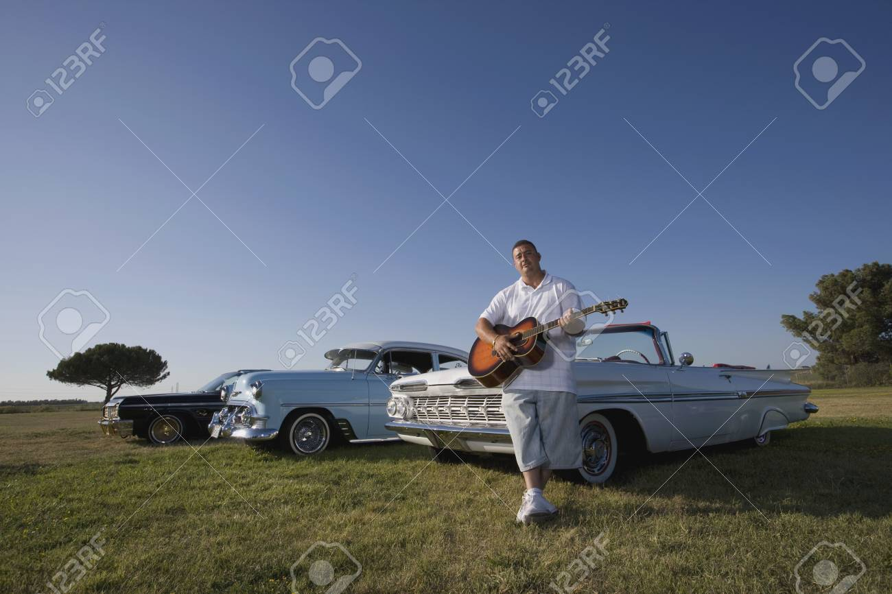Hispanic Man In Front Of Low Rider Cars Stock Photo Picture And