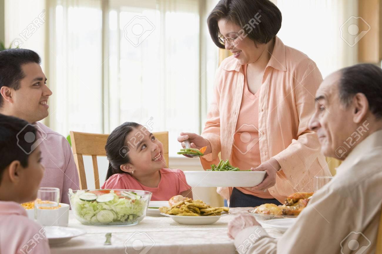Hispanic Family At Dinner Table Stock Photo
