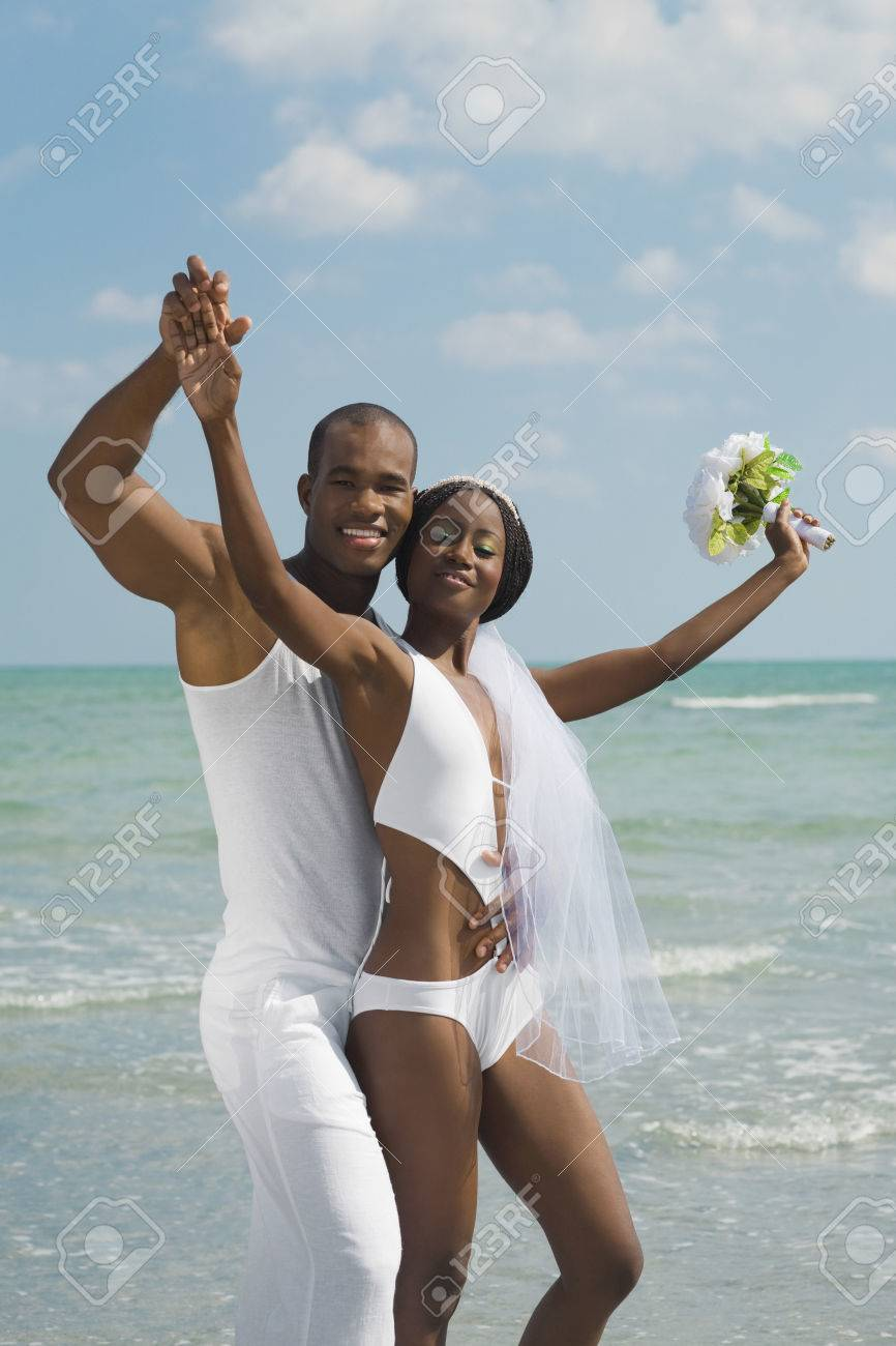 African Bride And Groom Hugging At Beach Stock Photo, Picture And ...