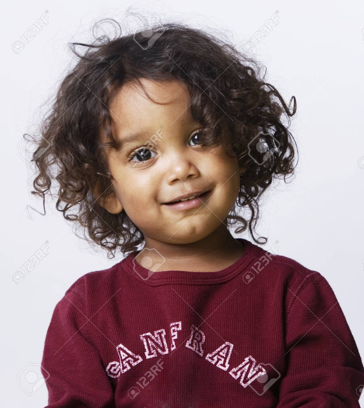 mixed race boy with curly hair