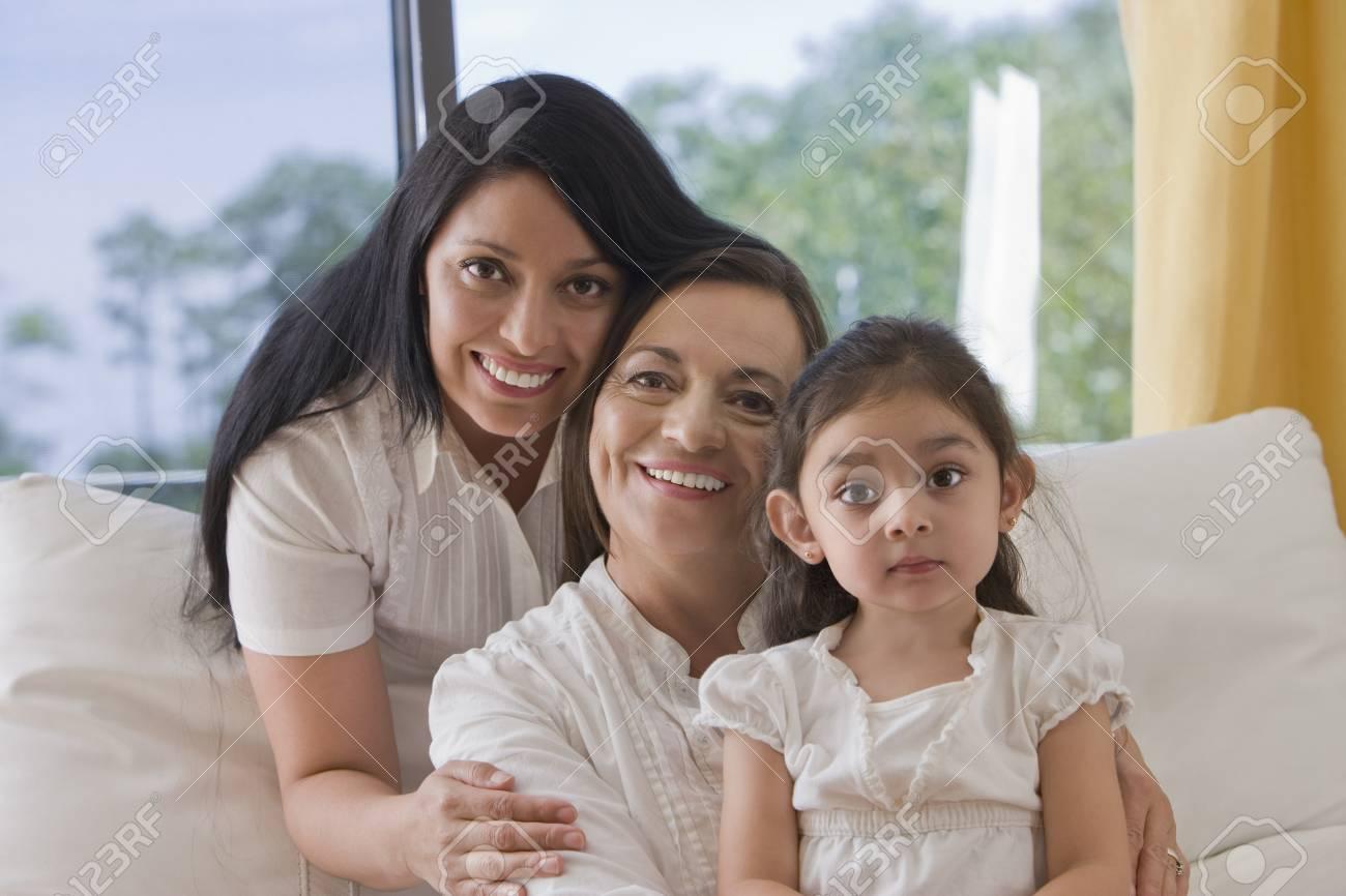 """Hispanic grandmother, mother and daughter"" - 107968889"