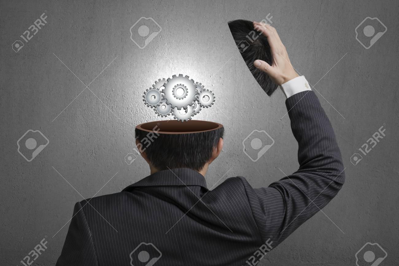 Working metal gears inside businessman head in gray concrete wall background Stock Photo - 22830995