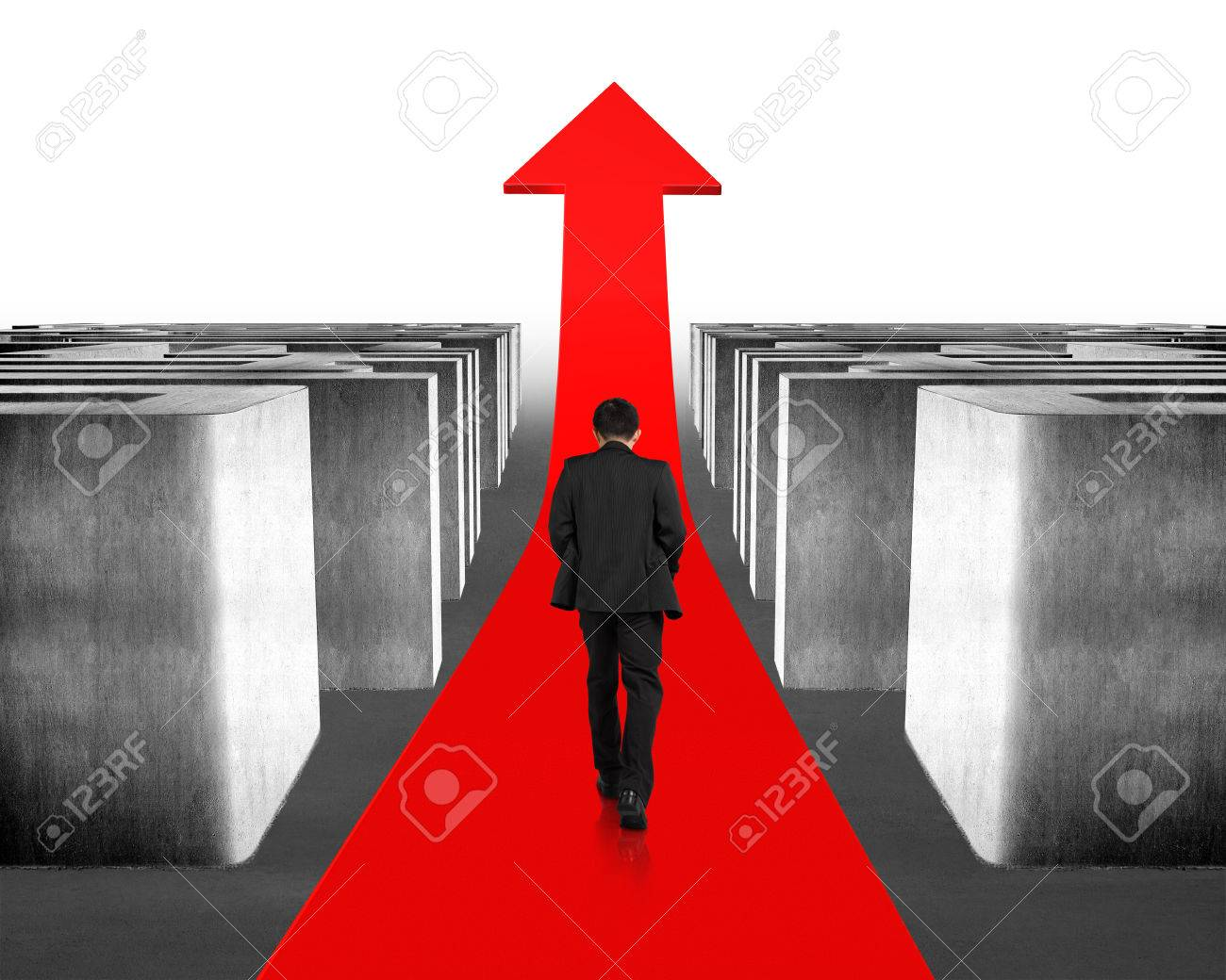 Walking on growing red arrow through 3d concrete maze Stock Photo - 26551155