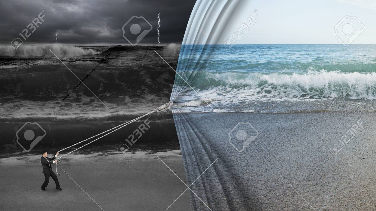 businessman pulling open calm sea curtain covered dark stormy ocean background - 34124783