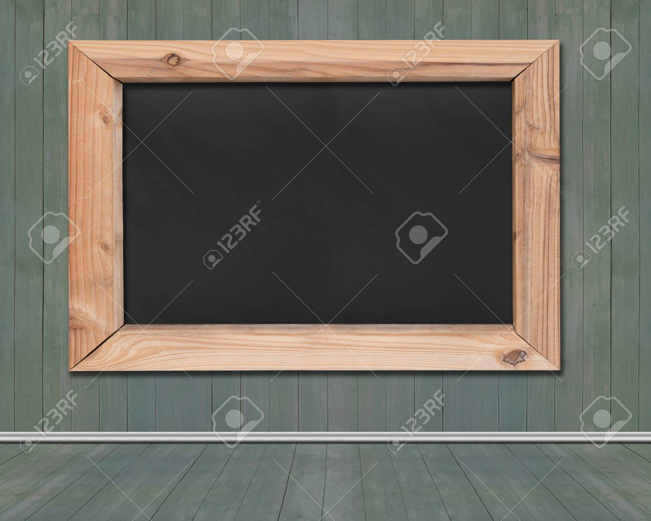 Blank Black Board With Wooden Frame Hanging On Green Wood Wall Stock ...