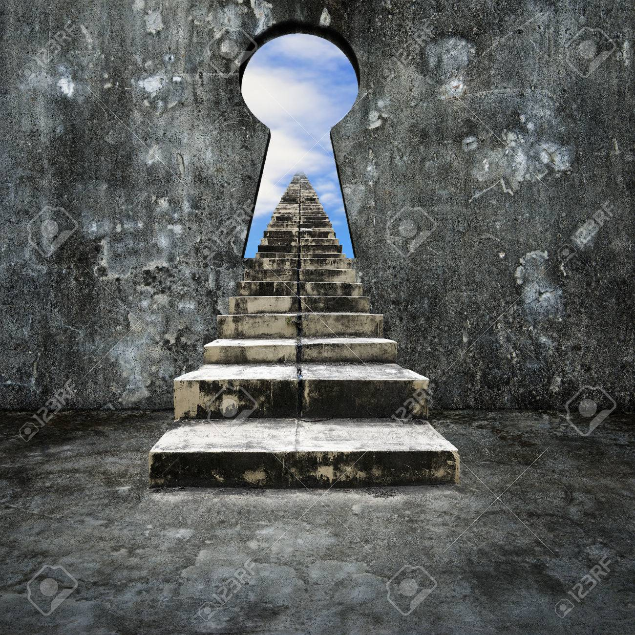 Keyhole on concrete wall with dirty stairs and sky clouds view. - 42934693