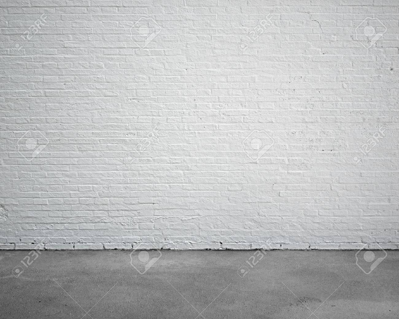 room interior with white brick wall and concrete floor, nobody, empty - 52366940