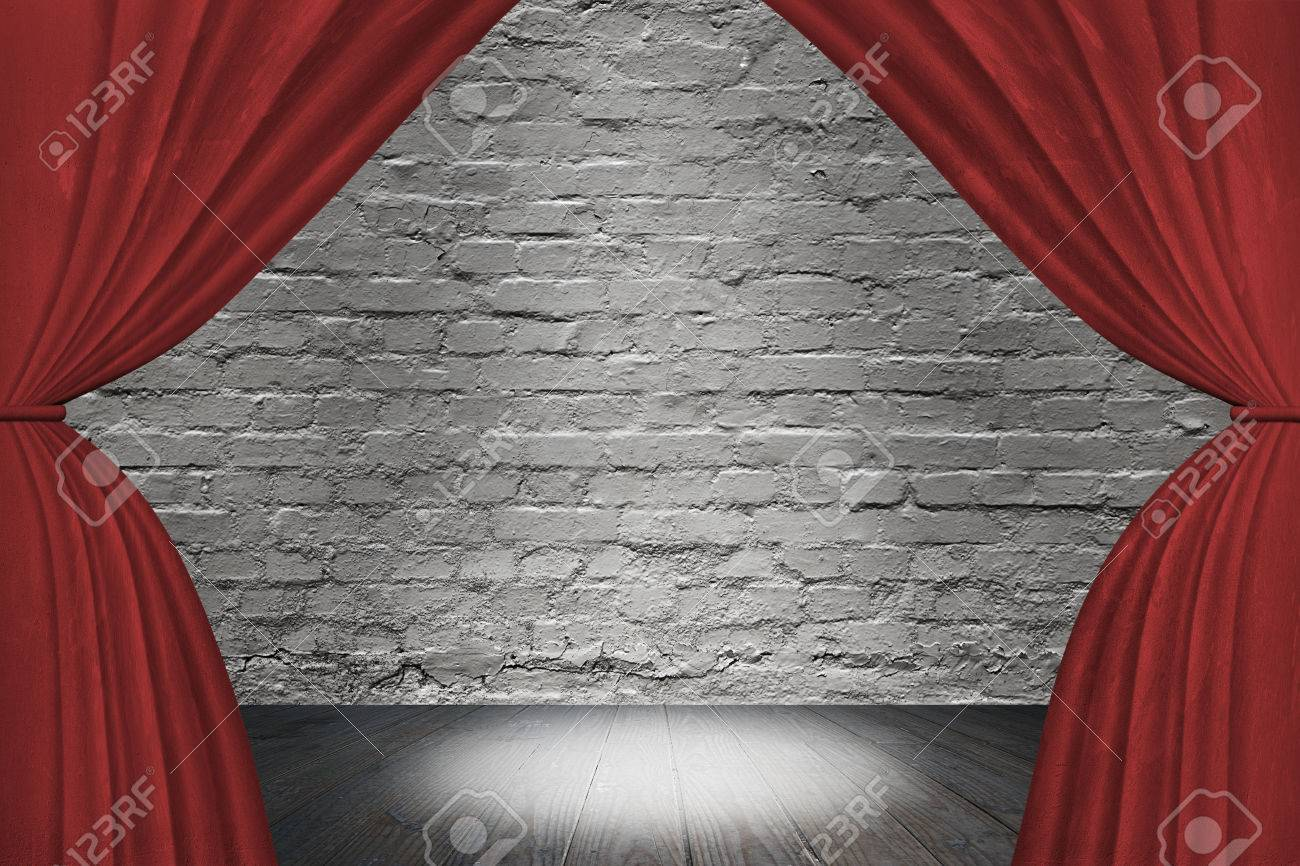 Red curtains with spotlight - Spotlight On Stage With Red Curtains On Old Brick Wall Background Stock Photo