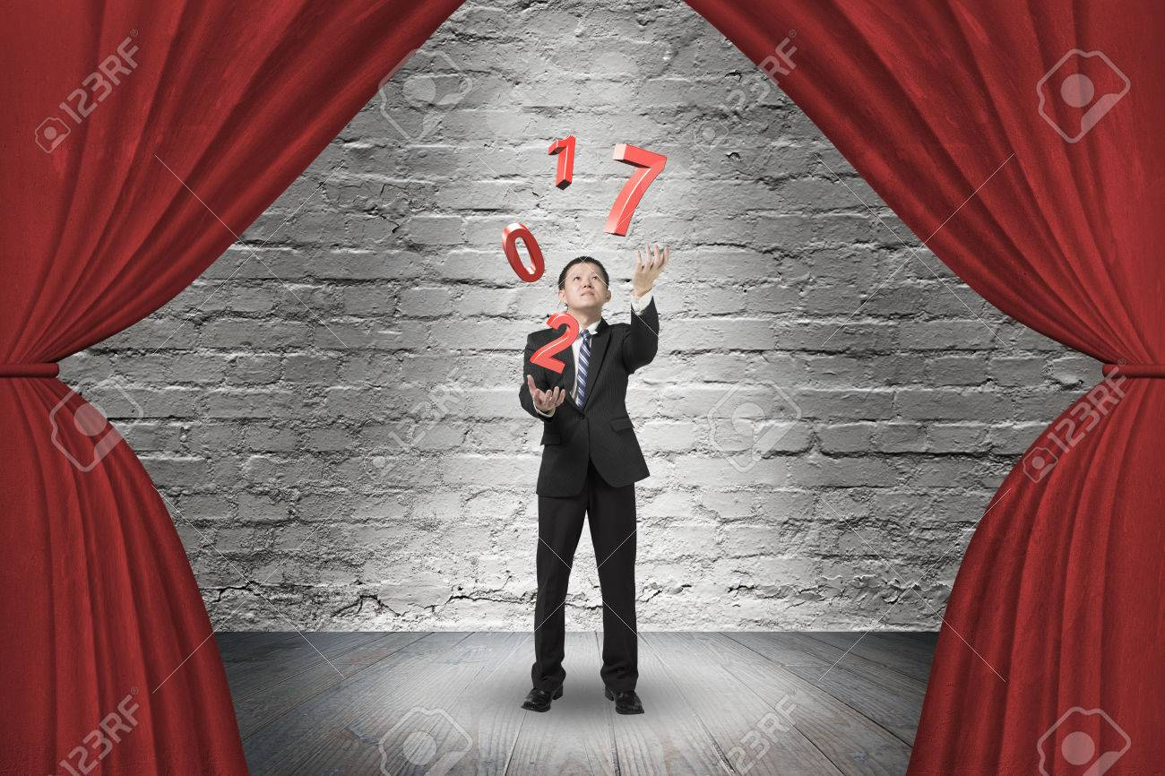Red curtain spotlight - Businessman Catching Throwing 2017 Red Words On Red Curtain Stage With Spotlight On Old Brick