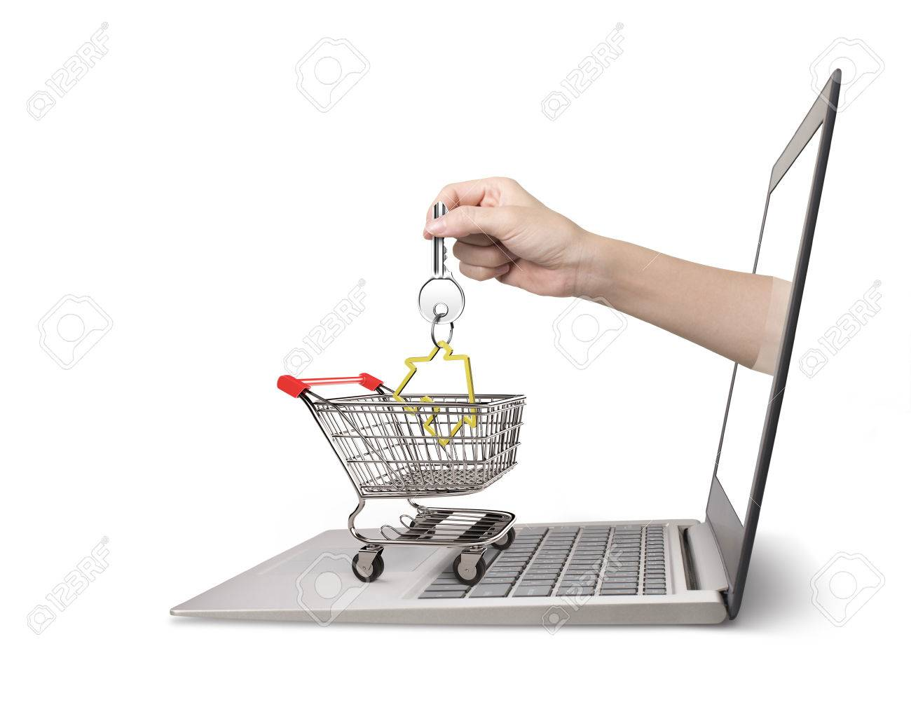 Female hand from laptop screen taking house key in the shopping female hand from laptop screen taking house key in the shopping cart isolated on white ccuart Choice Image