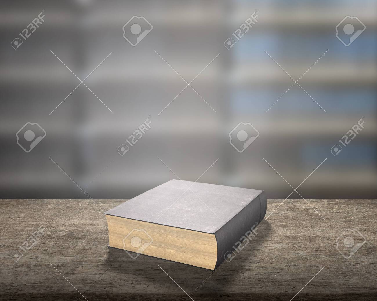 A Old Book On Wooden Desk With Blur Bookcase Background In The