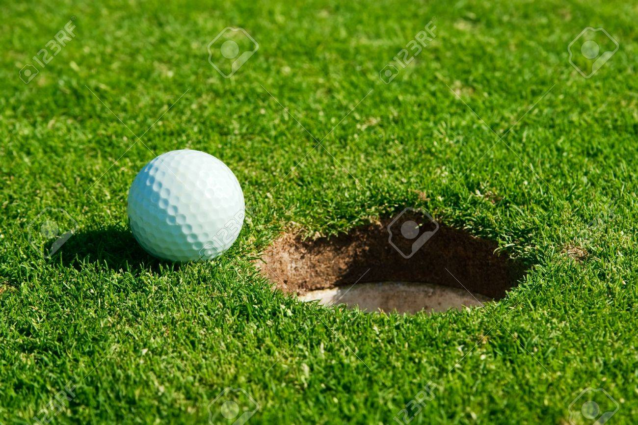 golf ball and hole Stock Photo - 8186087