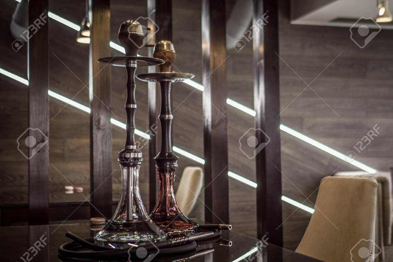 Beautiful Glass Hookah On A Wooden Table In A Hookah Bar Stock