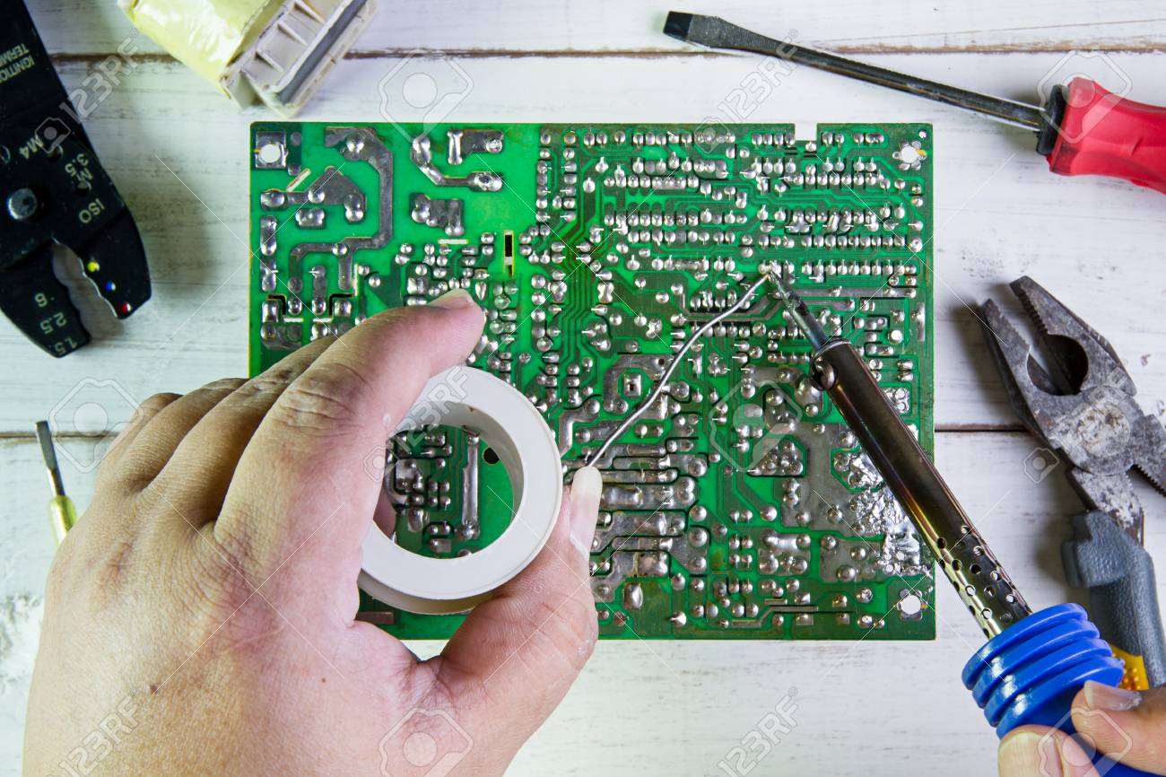 Serviceman Soldering Circuit Board With Iron In The Rcuit Service Workshop Stock Photo 56872009