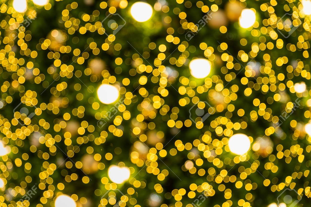 Blurred and bokeh of Christmas lighting in full screen background