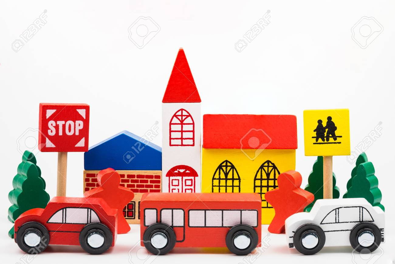 road traffic with wooden toy cars in the town on white background,..