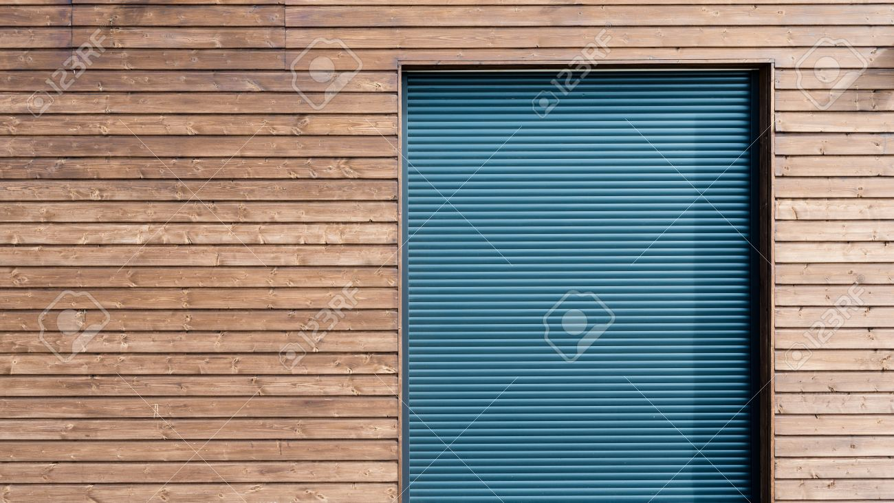 Modern Wooden Siding With Gray Aluminum Shutters Stock Photo   75477337