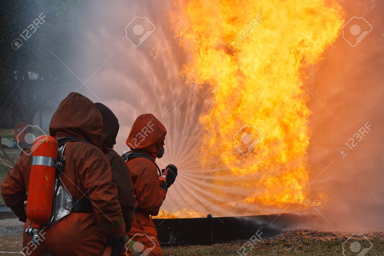 Firefighters fighting fire during training Stock Photo - 9849262