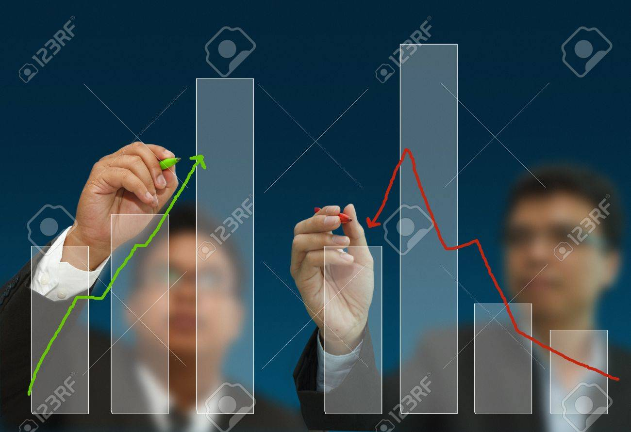 Two business men draw competition arrows and charts Stock Photo - 10373167