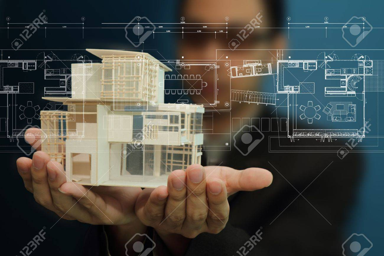 Businessman present house model and plan on touch screen Stock Photo - 10378232