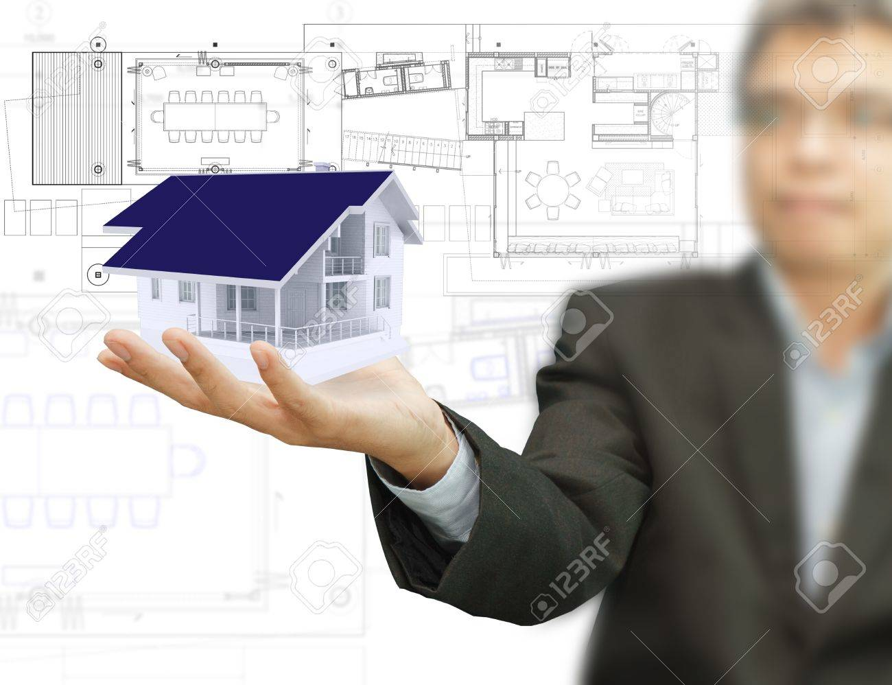 Businessman present house model and plan on touch screen Stock Photo - 12002126