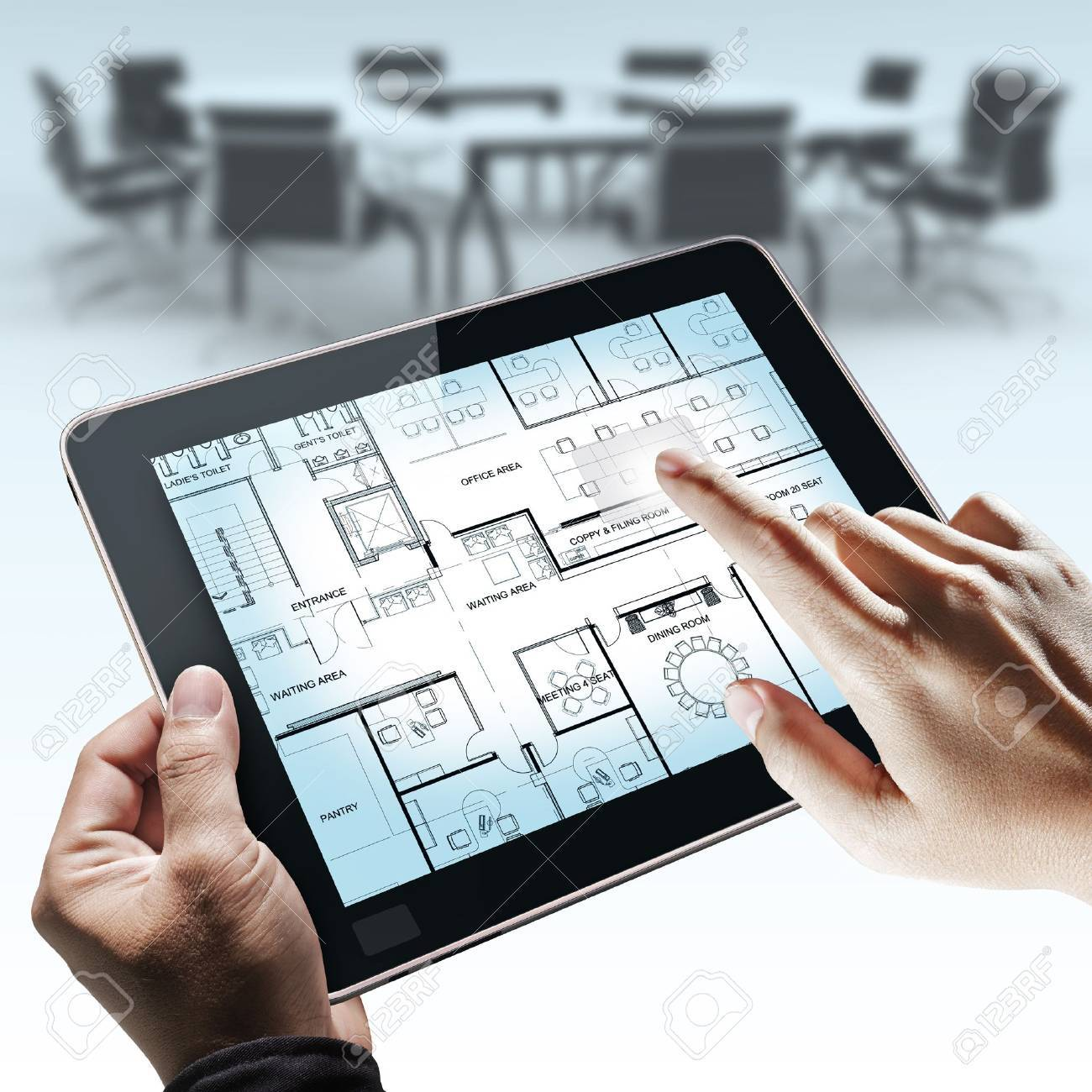 business hand point on interior layout plan on tablet computer as meeting concept Stock Photo - 11321650