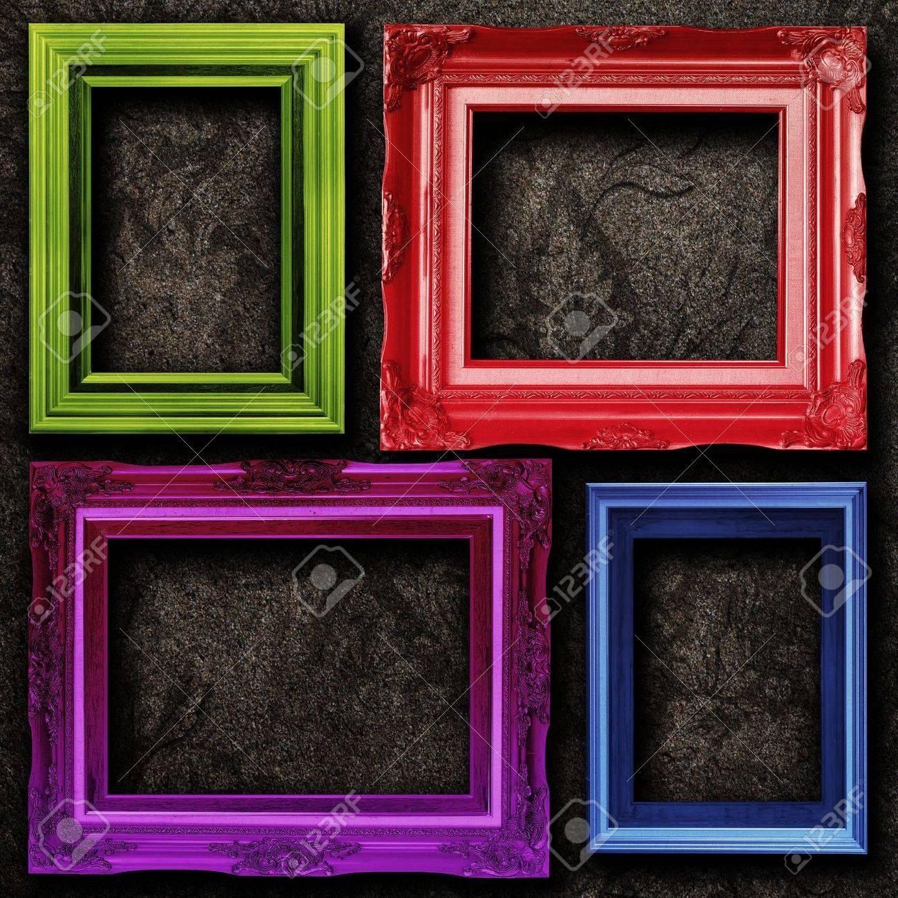 four contemporary picture frames vibrant colors on dirt wall  - four contemporary picture frames vibrant colors on dirt wall backgroundstock photo
