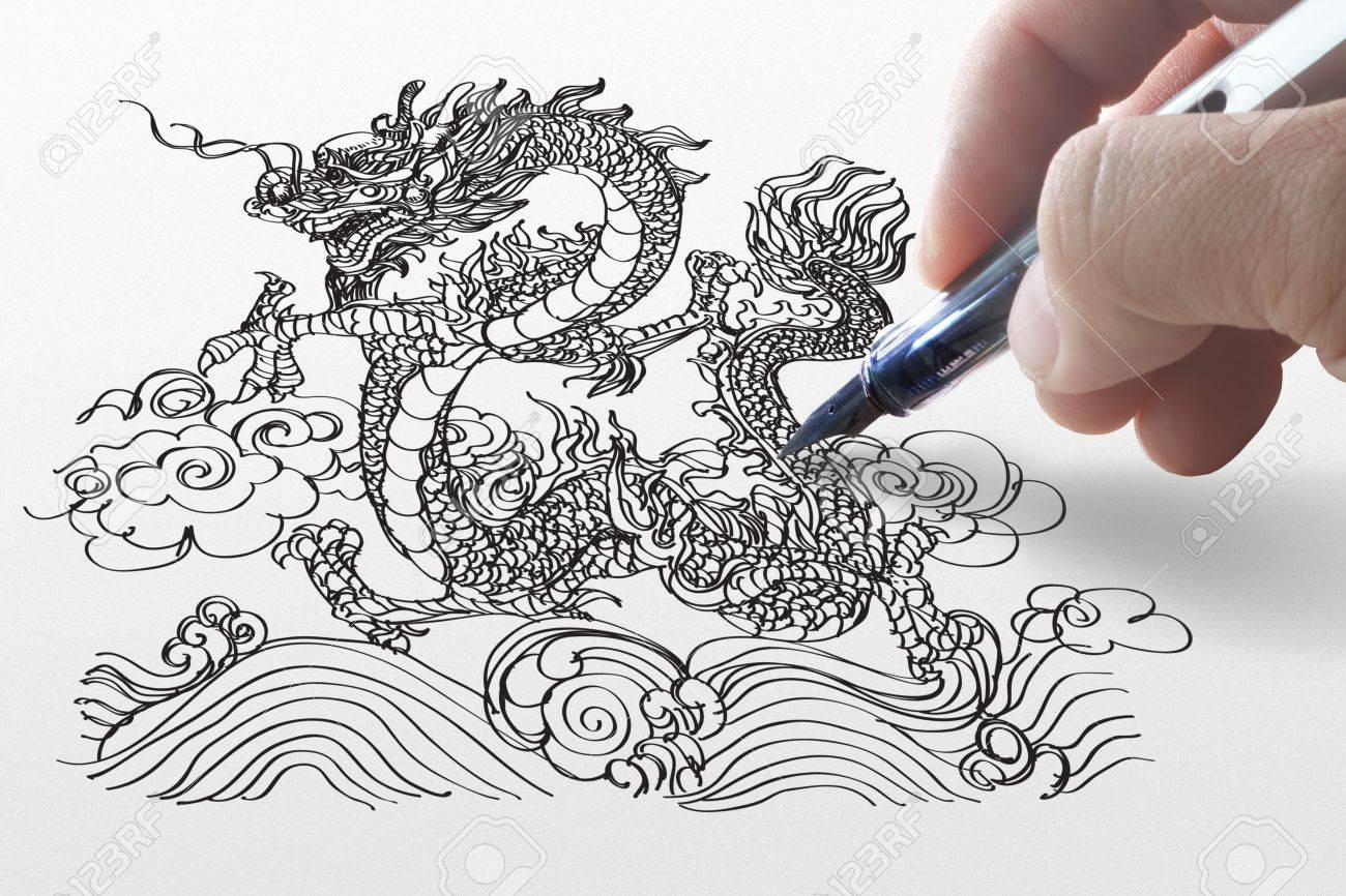 hand draws dragon on paper Stock Photo - 11739402