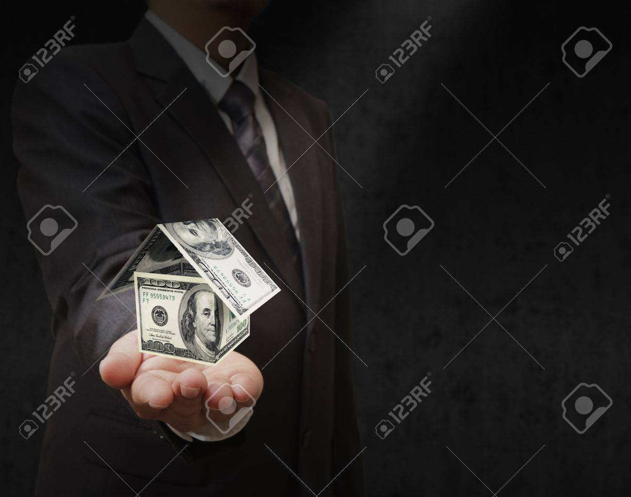 Businessman hand holds a dollar house Stock Photo - 11844103