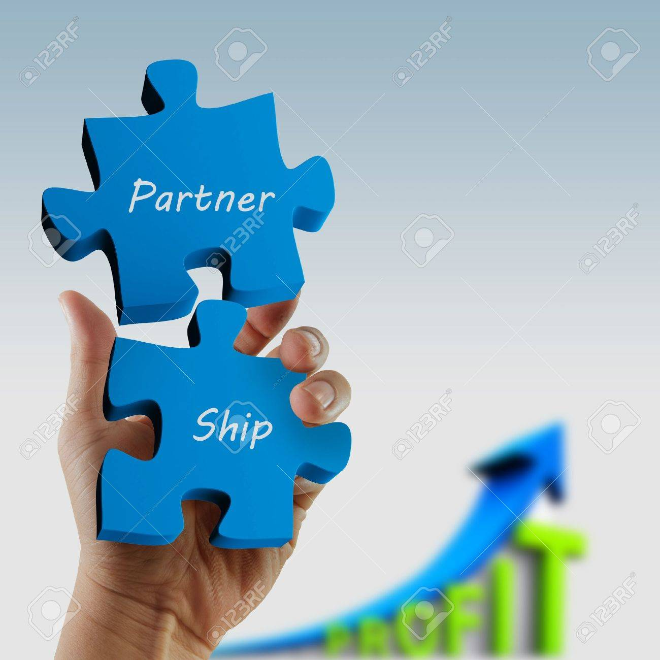 partnership  written puzzle pieces in hand Stock Photo - 12909911