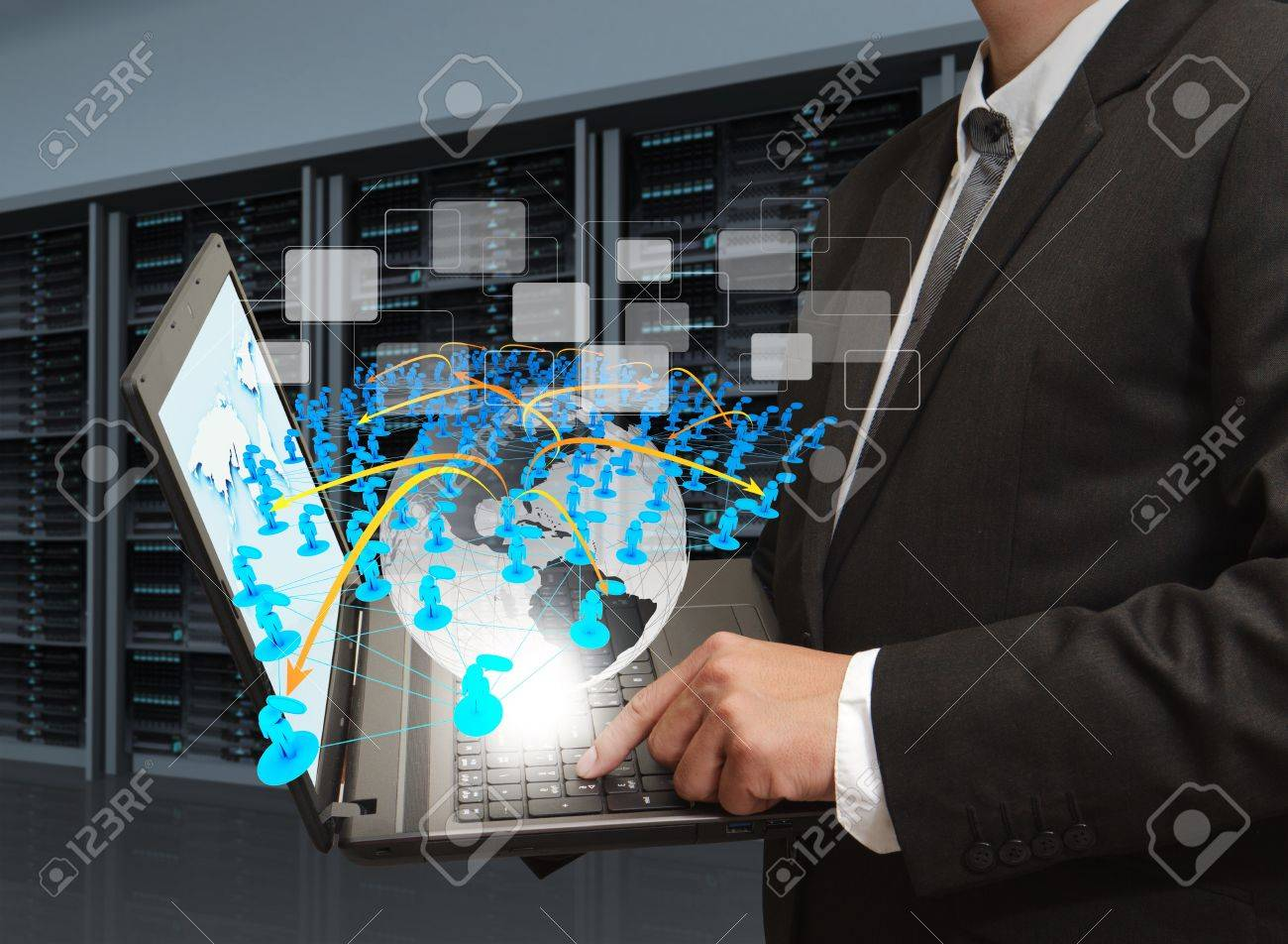 business man holds laptop computer and social network in server room Stock Photo - 13181572