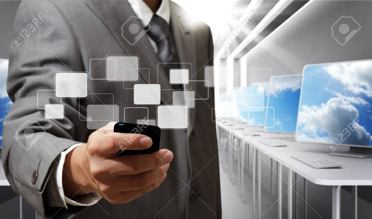 stock photo business man holds touch screen mobile phone in computer room business computer